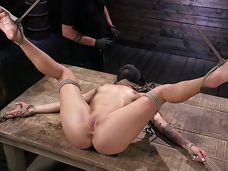 Curvy chick Kissa Sins gets her pussy toyed and punished on every side the dark BDSM room