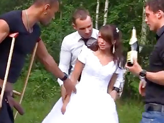 Russian bride enjoys an interracial gang-bang in sight