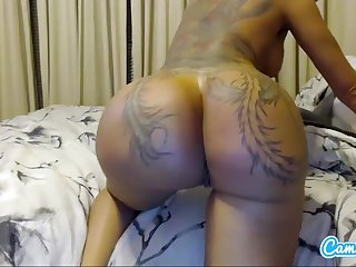 Inked pornstar Lizza Belzz strokes added to toys her pussy up ahead shaking her round booty on the top of webcam