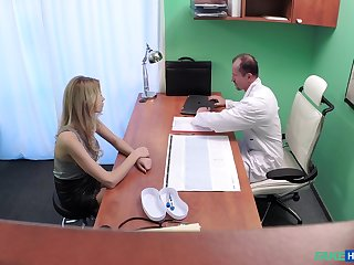 Naughty doctor fucks his chap-fallen blonde patient from behind. Spy cam